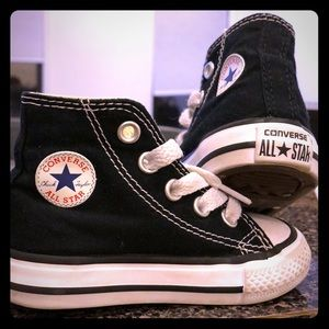 Size 4 Black Hightop all star converse sneakers.